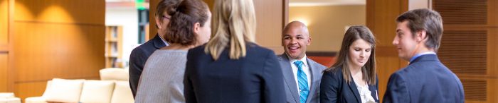 Photo of Wake Forest Law students shaking hands with employers.